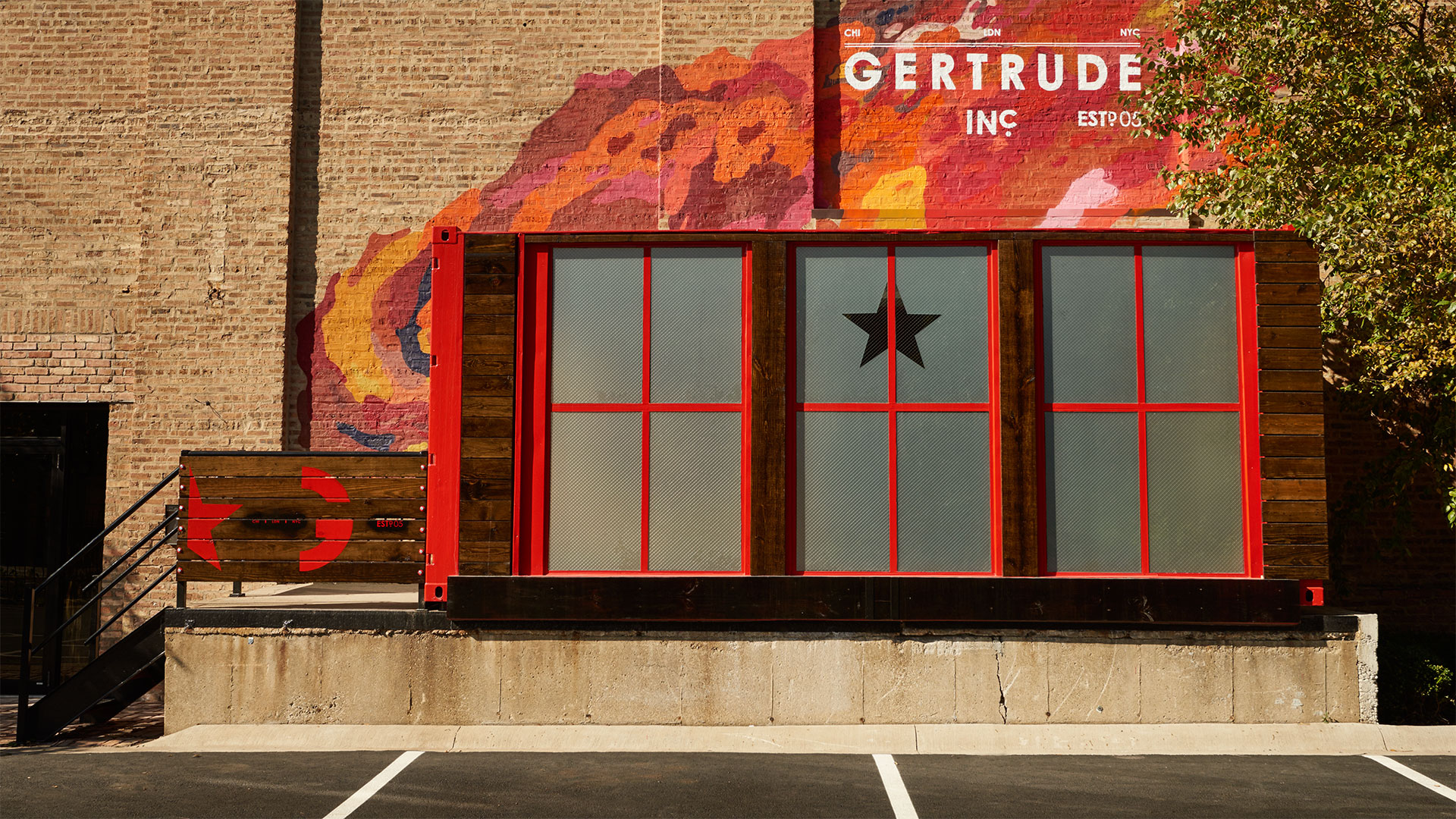 Gertrude, Inc. Agency Custom Designed Red Shipping Container Entrance and Branding